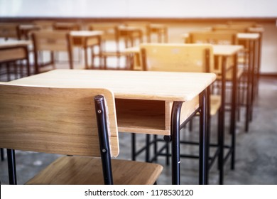 School empty classroom, Lecture room with desks and chairs iron wood for studying lessons in highschool thailand without young student, interior of secondary education with whiteboard