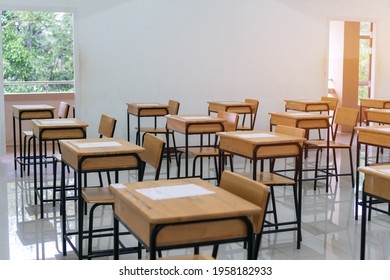 School empty classroom with test sheet or exams paper on desks chair wood at high school thailand, Empty classroom no childrens when COVID-19 disease outbreak and closed quarantine