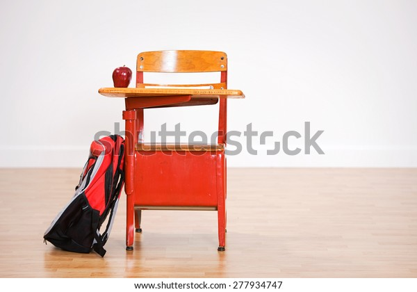 School: Empty School Desk With Apple And Backpack