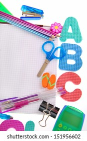 school equipment with a,b,c letters,notebook and accessories isolated on white