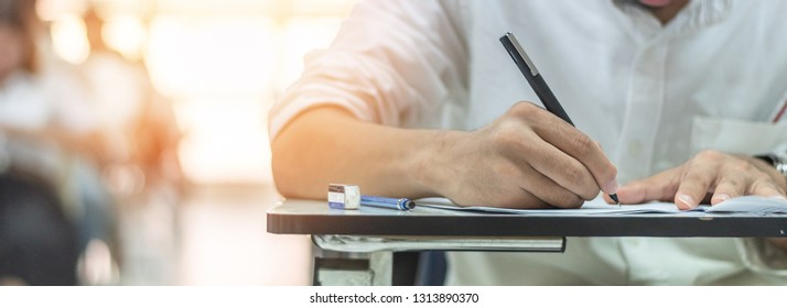 School exam, student taking educational admission test in class, thinking hard, writing answer in university classroom, education and world literacy day concept