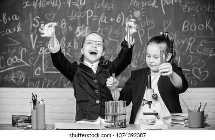 School experiment. School for gifted children. Girls school uniform excited proving their hypothesis. School project investigation. Gymnasium students with in depth study of natural sciences.