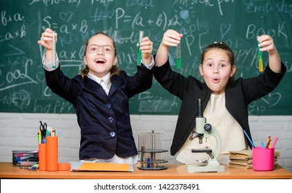 School experiment. Girls school uniform excited proving their hypothesis. School for gifted children. Gymnasium students with in depth study of natural sciences. School project investigation.