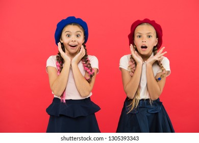 School fashion concept. Surprised girls wear formal uniform red background. International exchange school program. Education abroad. Apply form enter international school. French language school.