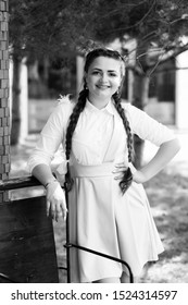 School fashion. Modern schoolgirl outdoors. Schoolgirl happy smiling pupil with long braided braids. Beginning of academic year. Adorable schoolgirl. Time to study. Black and white