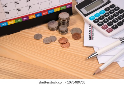 School fee past due final notice letter, education fee, desk calendar, calculator, money coin, pen and pencil on wooden table. School due date concept.