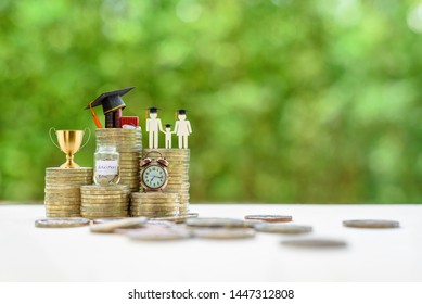 School funding, family saving for higher education concept : Black graduation cap, campus diploma, money jar, trophy cup of success or winner reward, clock on rising coins, depicts passage of success