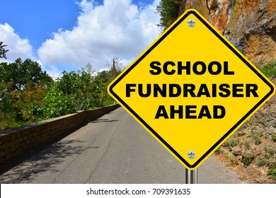 School fundraiser ahead yellow road sign