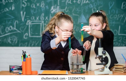 School for gifted children. Girls school uniform excited proving their hypothesis. Gymnasium students with in depth study of natural sciences. School project investigation. School experiment.