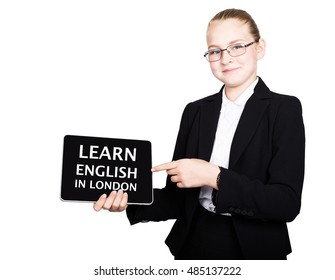 school girl in a business suit holds a pc tablet in his hands with inscription learn english in london