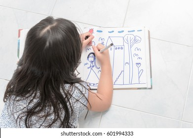 school girl drawing picture with color pen, education concept.