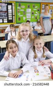 School girl friends smiling in classroom