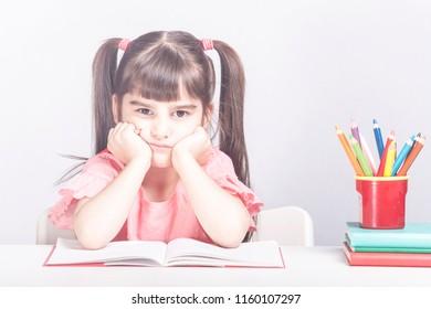 School girl having trouble with her homework