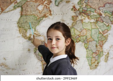 A school girl indicating the United States of America on a world map