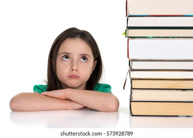 School girl looking up at the pile of books