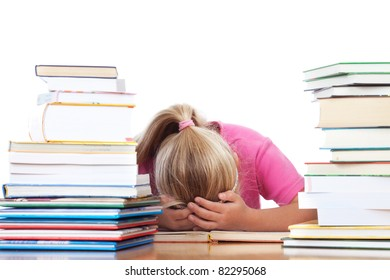 a school girl lying on desk frustrated between many books