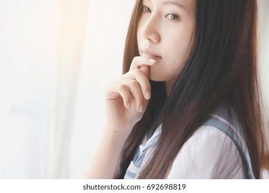 School girl on white room