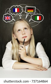 School Girl Pupil Learning English, German, French or Italian Language on the Blackboard Background with United Kingdom, Germany, Italy, France Flags