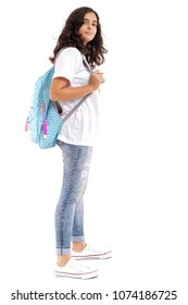 School girl standing in jeans with backpack