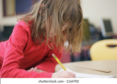 School girl writing