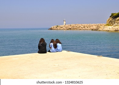 School girls relaxing at the seaside in Agva, Istanbul, Turkey.