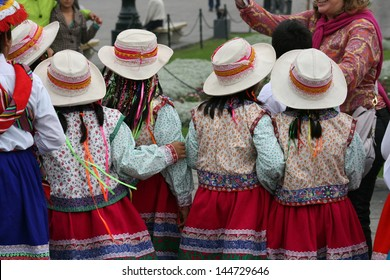 School girls in traditional native dress attend a festival in the plaza of Lima, Peru