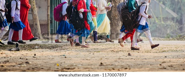 School girls walking in an urban road isolated unique photo