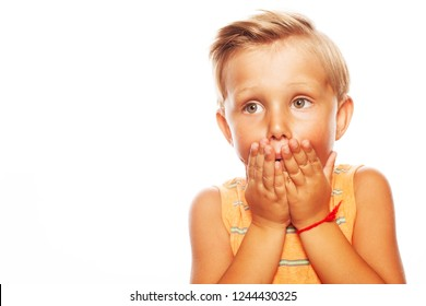 School Gossip concept. Portrait of unhappy cute little boy in orange sleeveless T-shirt isolated on white background. Close up. Copy-space. Studio shot