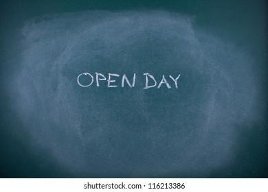 School invite to open day. Writing open day on school chalkboard (blackboard).