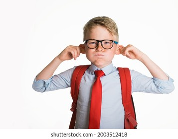 School kid boy making monkey face. Funny silly child boy grimacing isolated on white background. Pupil with big ears listening. Emotional face of caucasian blond kid with freckles looking at camera