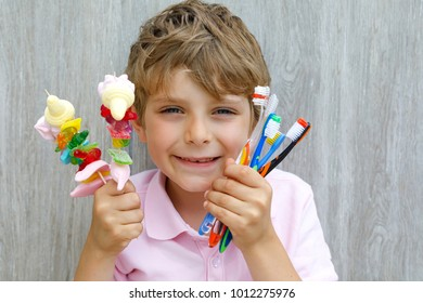 School kid boy with sweets as unhealthy food for children