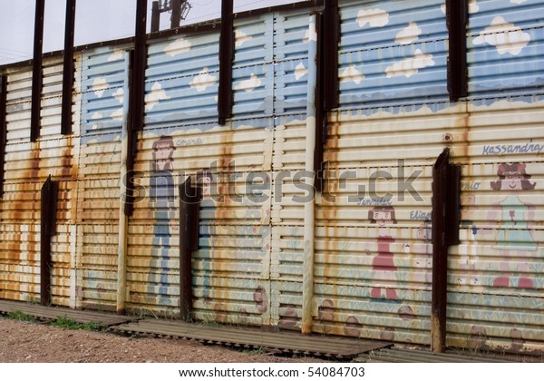 School kid decorations on the US to Mexico border wall in Arizona