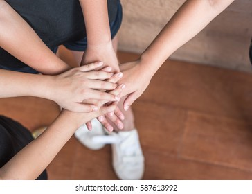 School kid, or girl scout's volunteer hands for friendship and community collaboration concept