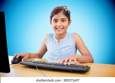 School kid on computer against blue background with vignette