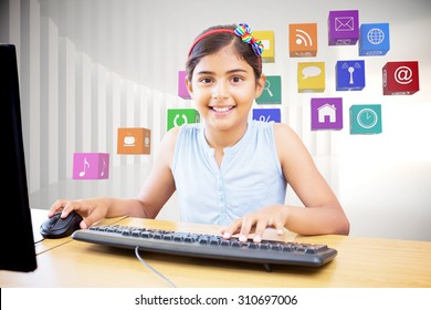 School kid on computer against white curved room