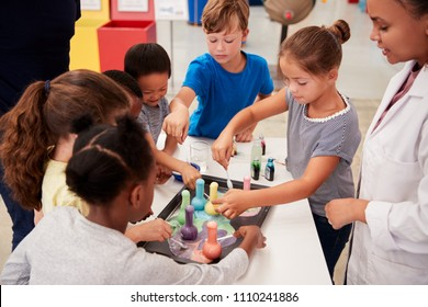 School kids taking part in experiment at science centre