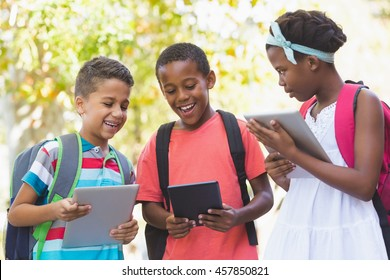 School kids using digital tablet at school campus