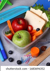 school lunch box with apple and sandwich