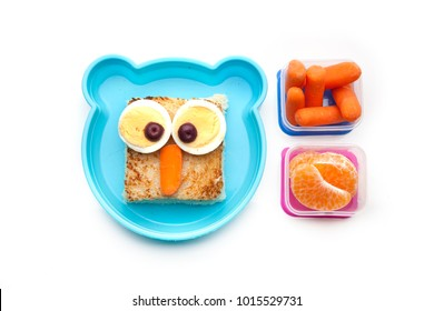 School lunch box snacks for kids over white background. Back to school. Healthy and fun snacks options for parents. Cute food art creative concepts. Bows with fruits and vegetables and cute sandwich.