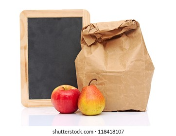 School lunch with fruit and black chalkboard ready for your text
