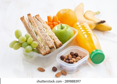 school lunch with sandwich on white table, close-up
