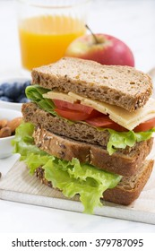 school lunch with sandwich of wholemeal bread, closeup, vertical
