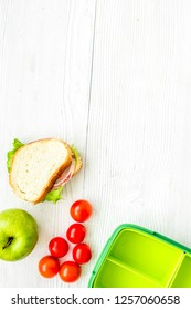 school lunch set with apple and vegetables in lunchbox backgroun