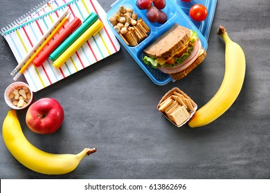 School lunch and stationery on table