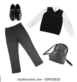 School male uniform with backpack on white background. Fashionable school set concept.