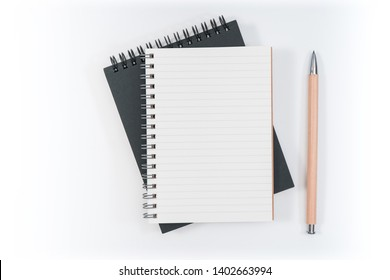 school notebook on a blue background, spiral notepad on a table