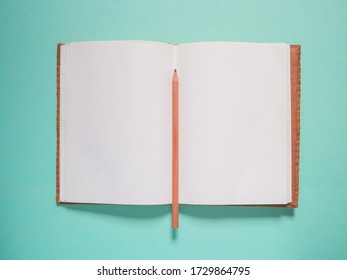 School notebook and pencil on a blue background
