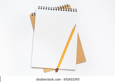 School notebook with pencil on table