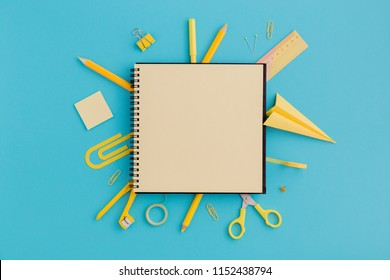 School notebook and various stationery. Back to school concept. Creative flat lay desk.