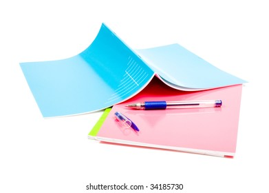 school notebooks with pencil on top at white background
